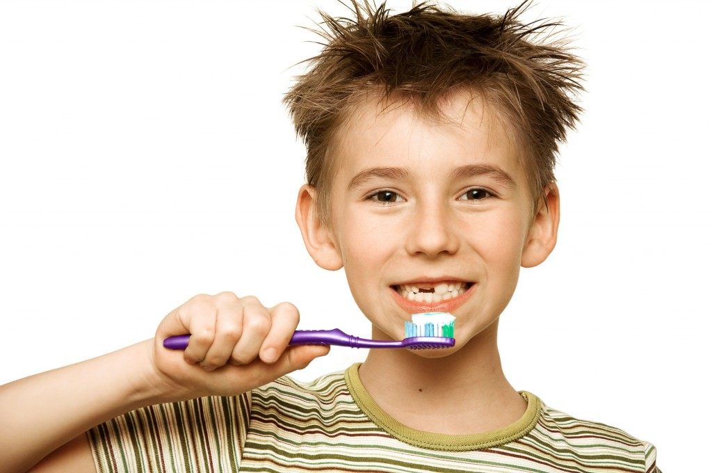9565567 - beautiful boy brushing teeth, isolated on white