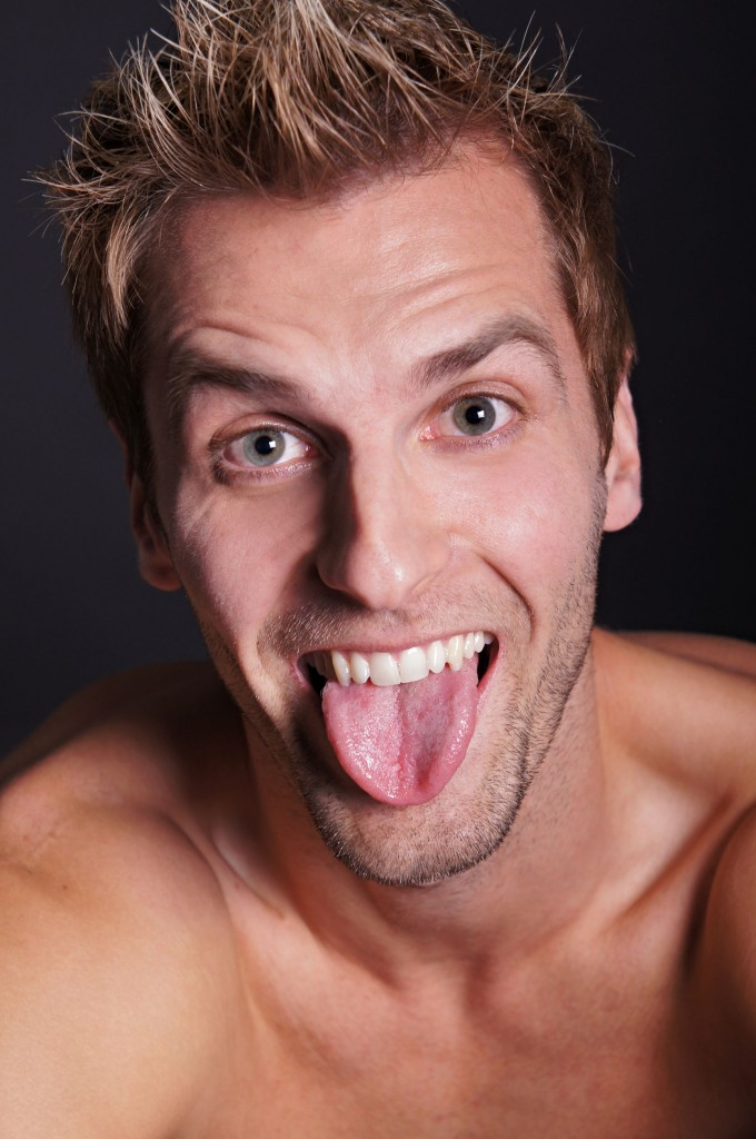 41737512 - young crazy man sticks out his tongue