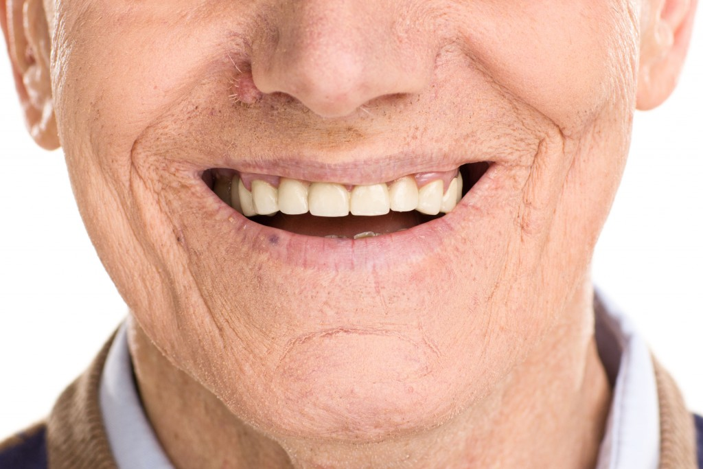 52452076 - close-up on cheerful senior man smiling isolated on white background