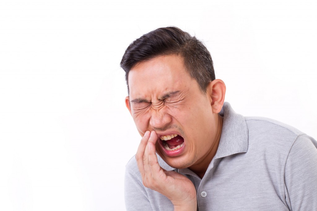 43223101 - man suffering from toothache, tooth sensitivity
